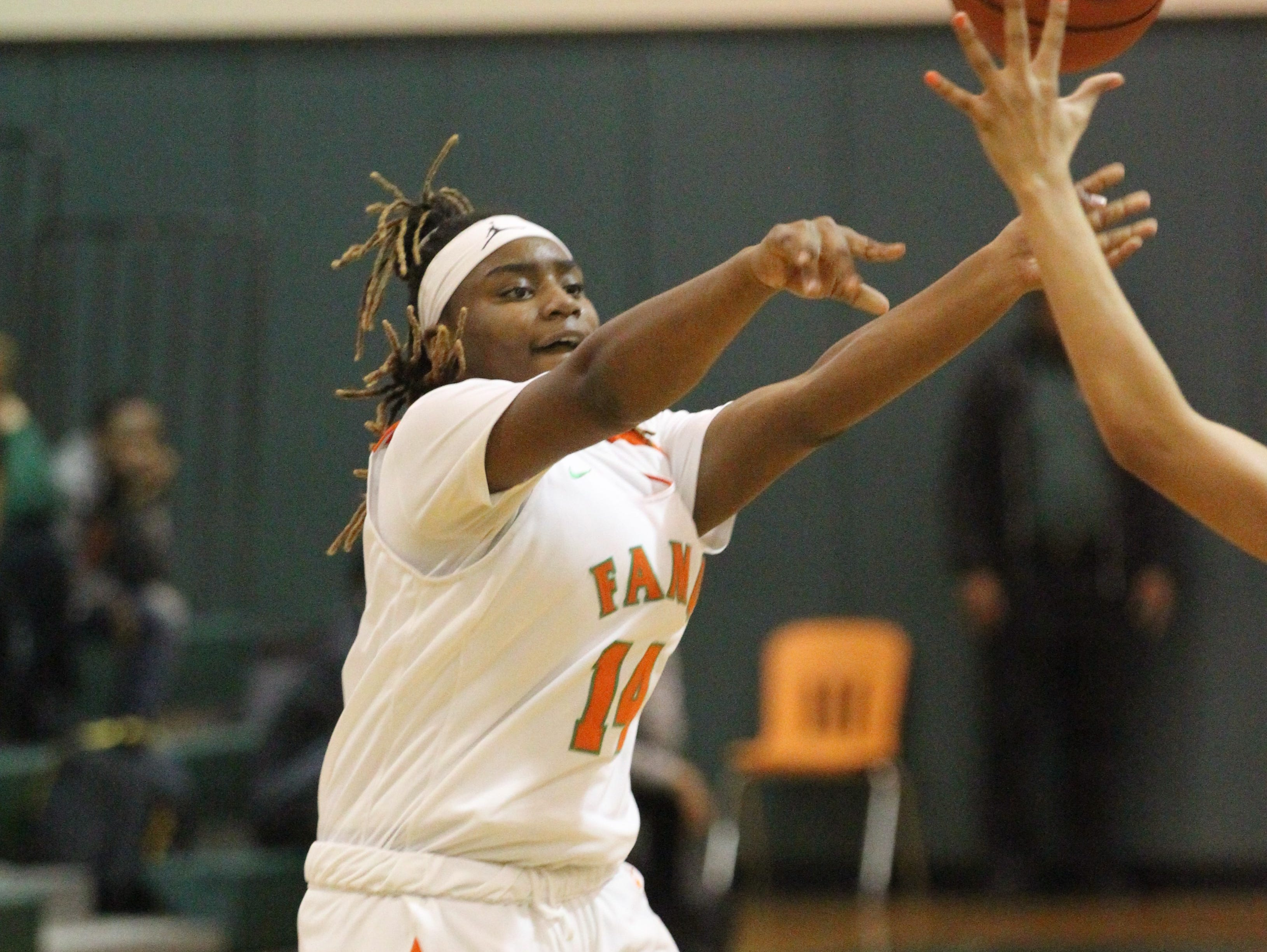 FAMU DRS freshman Ameari Logan throws a pass over the top as FAMU DRS' girls basketball team beat NFC 59-41 for a District 1-3A title on Jan. 7, 2019.