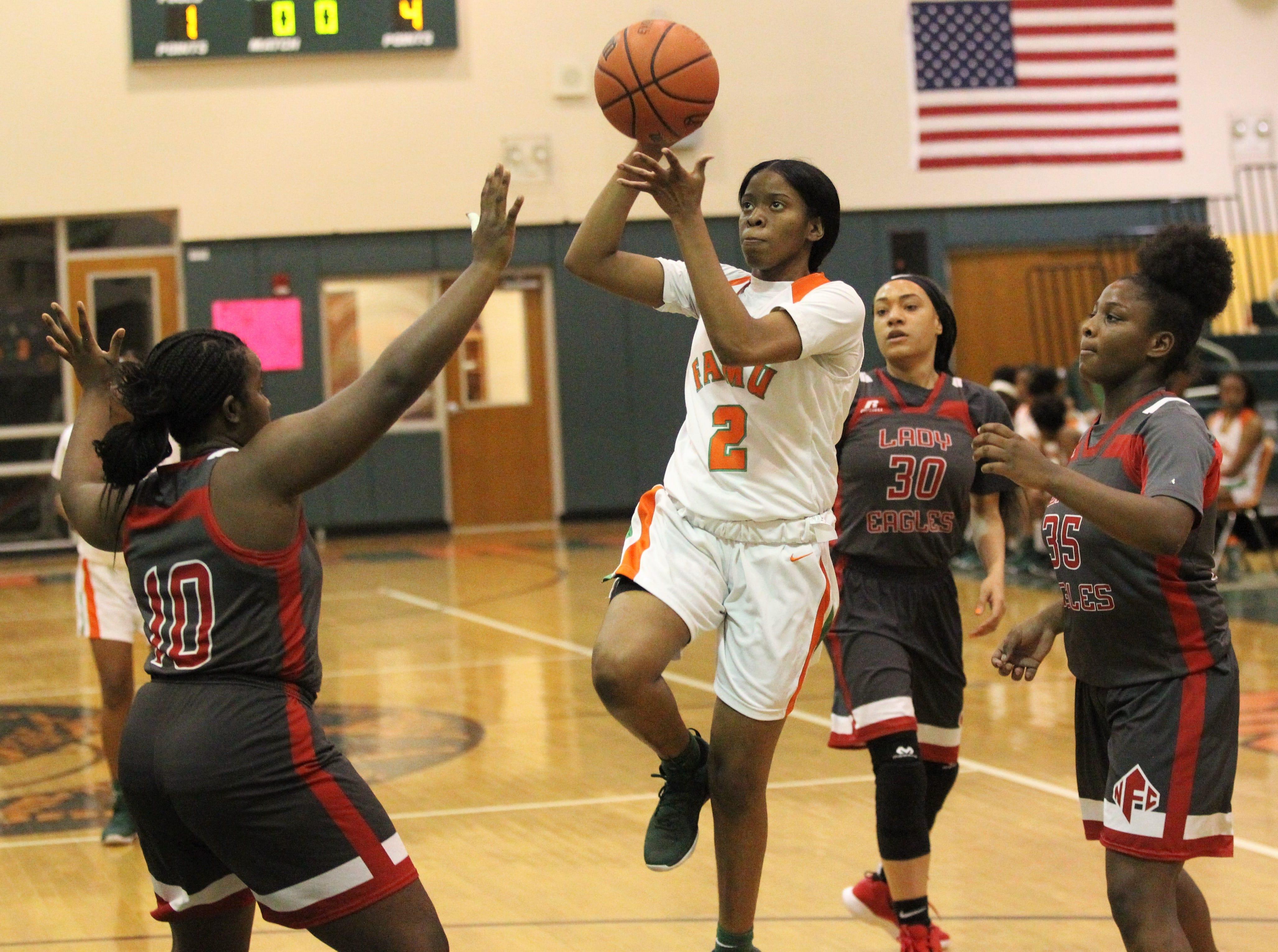 FAMU DRS senior Diamond Douglass shoots a runner as FAMU DRS' girls basketball team beat NFC 59-41 for a District 1-3A title on Jan. 7, 2019.
