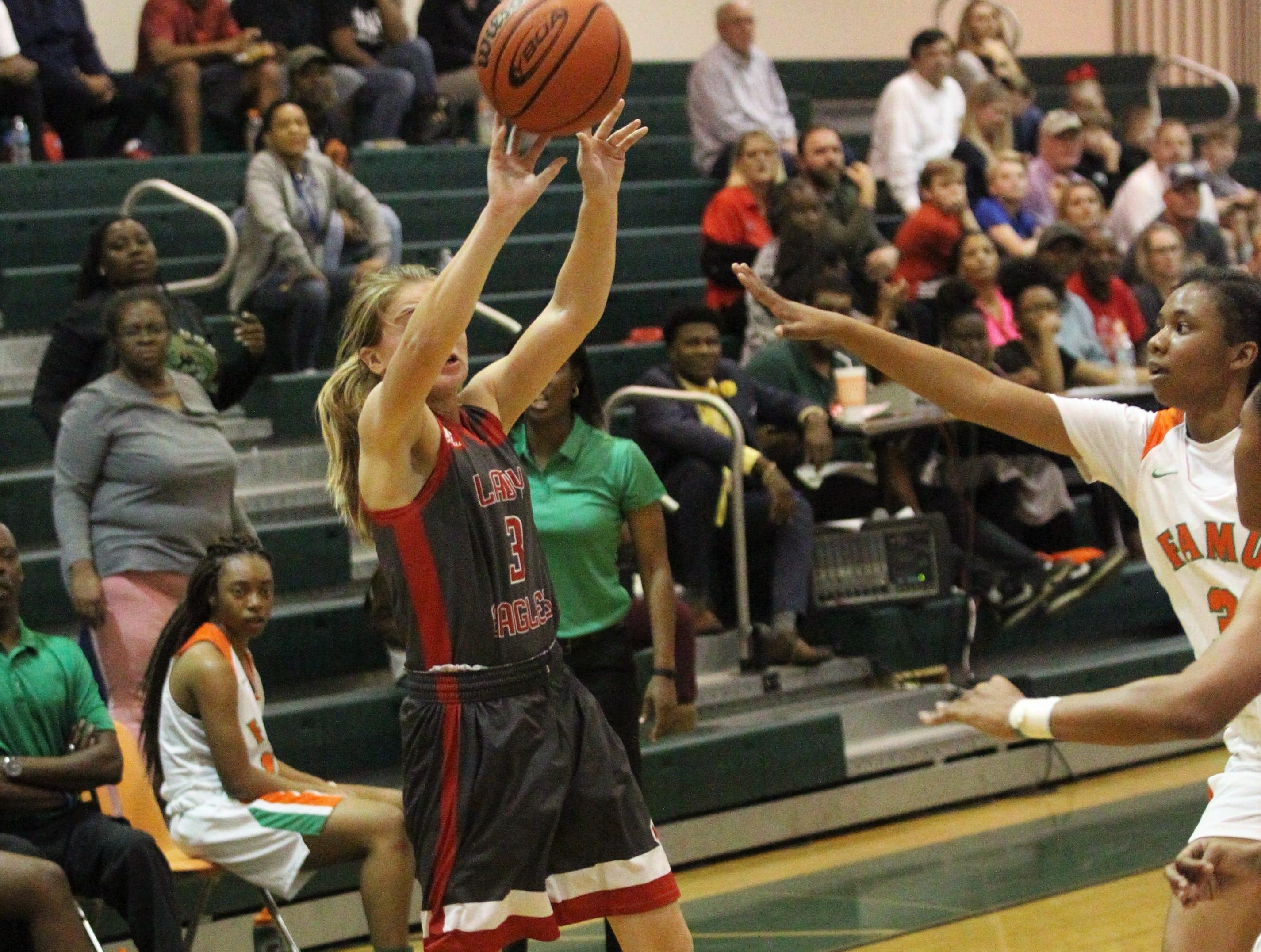 NFC freshman Emma Brice shoots an off-balance shot as FAMU DRS' girls basketball team beat NFC 59-41 for a District 1-3A title on Jan. 7, 2019.