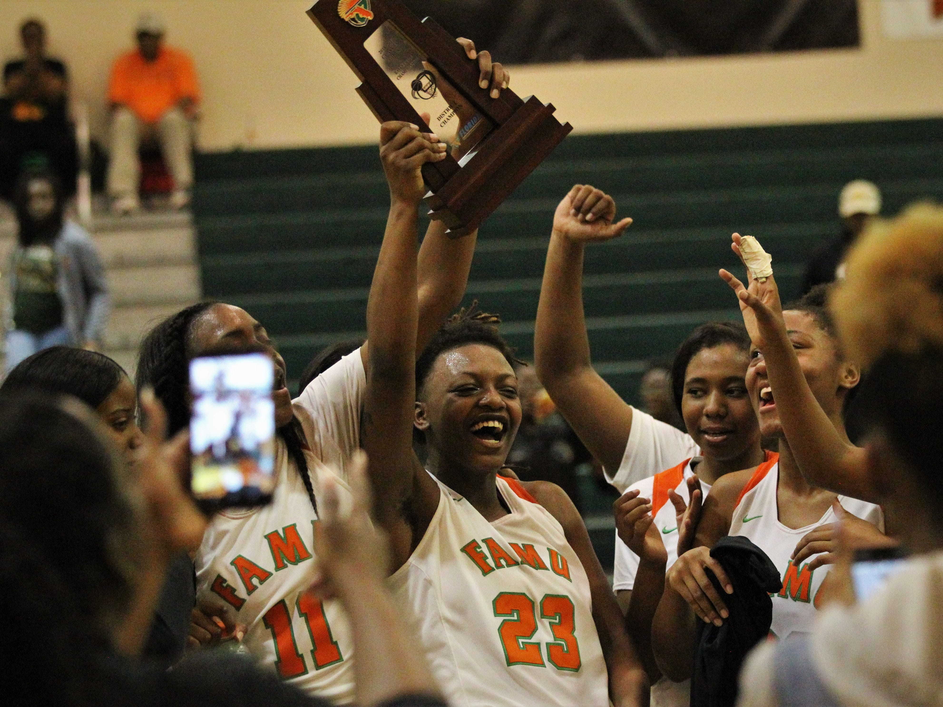 FAMU DRS senior Ayleshia Vickers (23) celebrates the Rattlers' District 1-3A championship after beating NFC 59-41 on Jan. 7, 2019.