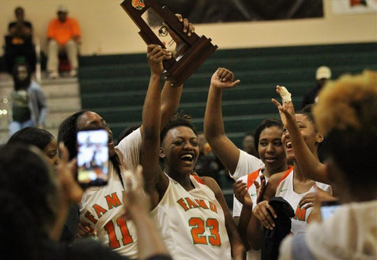 FAMU DRS senior Aylesia Vickers (23) celebrates the Rattlers' District 1-3A championship after beating NFC 59-41 on Jan. 7, 2019.