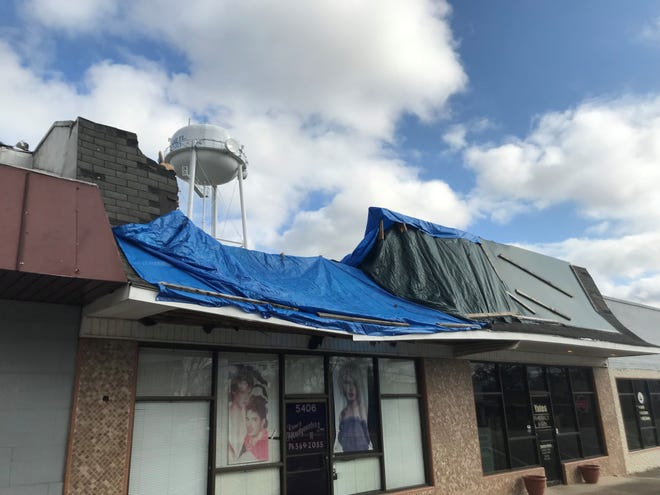 Roofing problems at the salon next door to Yates Pharmacy is causing flooding problems for the merchant.