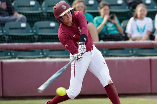 Florida State Seminoles infielder Cali Harrod (10) swings at the pitch as the Florida State Seminoles host the UNC Wilmington Seahawks in their first game of the season at the Joanne Graf Stadium, Friday Feb. 8, 2019.