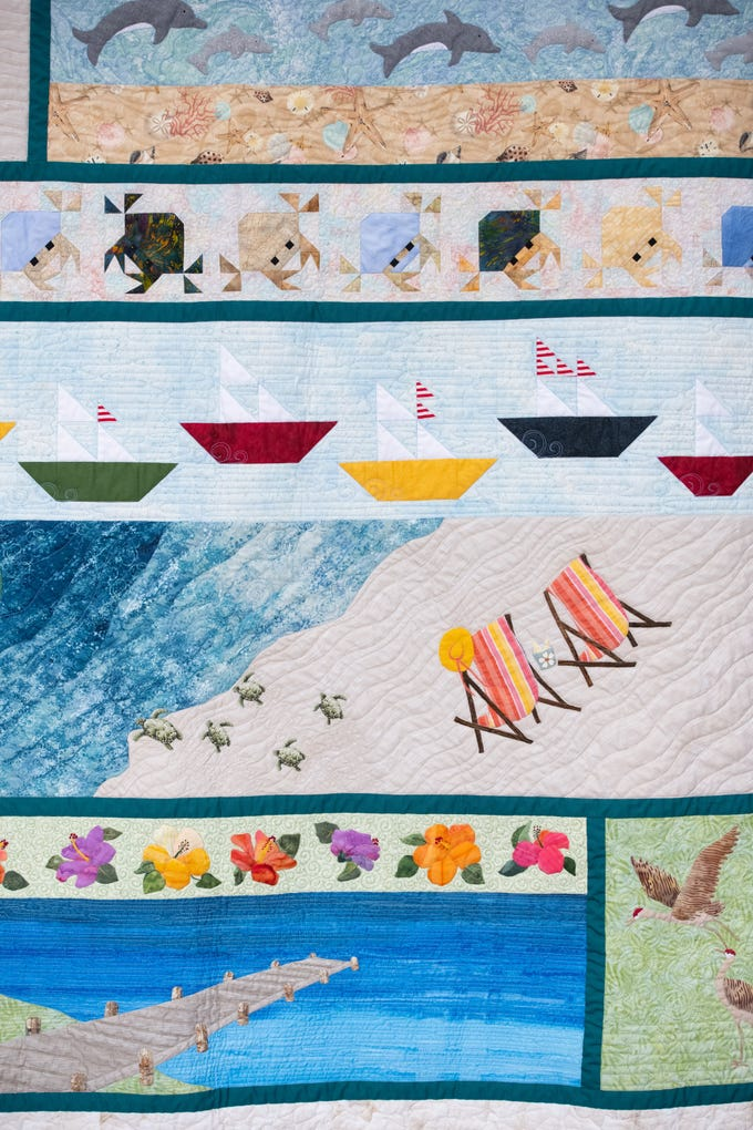 "A detail of the Vero Beach Centennial Quilt named ""A Day at the Beach"" hangs at the 40th anniversary Sunbonnet Sue Quilter's Guild Show at the Indian River County Fairgrounds on Friday, Feb. 8, 2019, in Vero Beach. The show continues Saturday from 10 a.m. to 4 p.m."