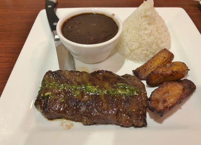 The marinated churrasco with chimichurri sauce was tender and  flavorful at Dom Rico Cafe.