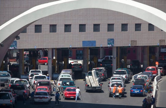 This June 1, 2009 file photo shows vehicles waiting to enter the U.S. through The Dennis DeConcini Port of Entry in downtown Nogales, Arizona. The mayor of Nogales says the port of entry on the U.S.-Mexico border was closed for hours after a customs officer shot and killed a southbound driver who refused to stop Thursday night.
