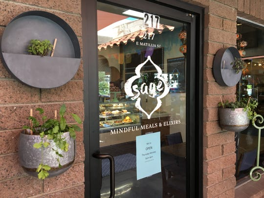 Herb plantings flank the front door at Sage Mindful Meals & Elixirs in Ojai. The newly opened restaurant also serves baked goods.