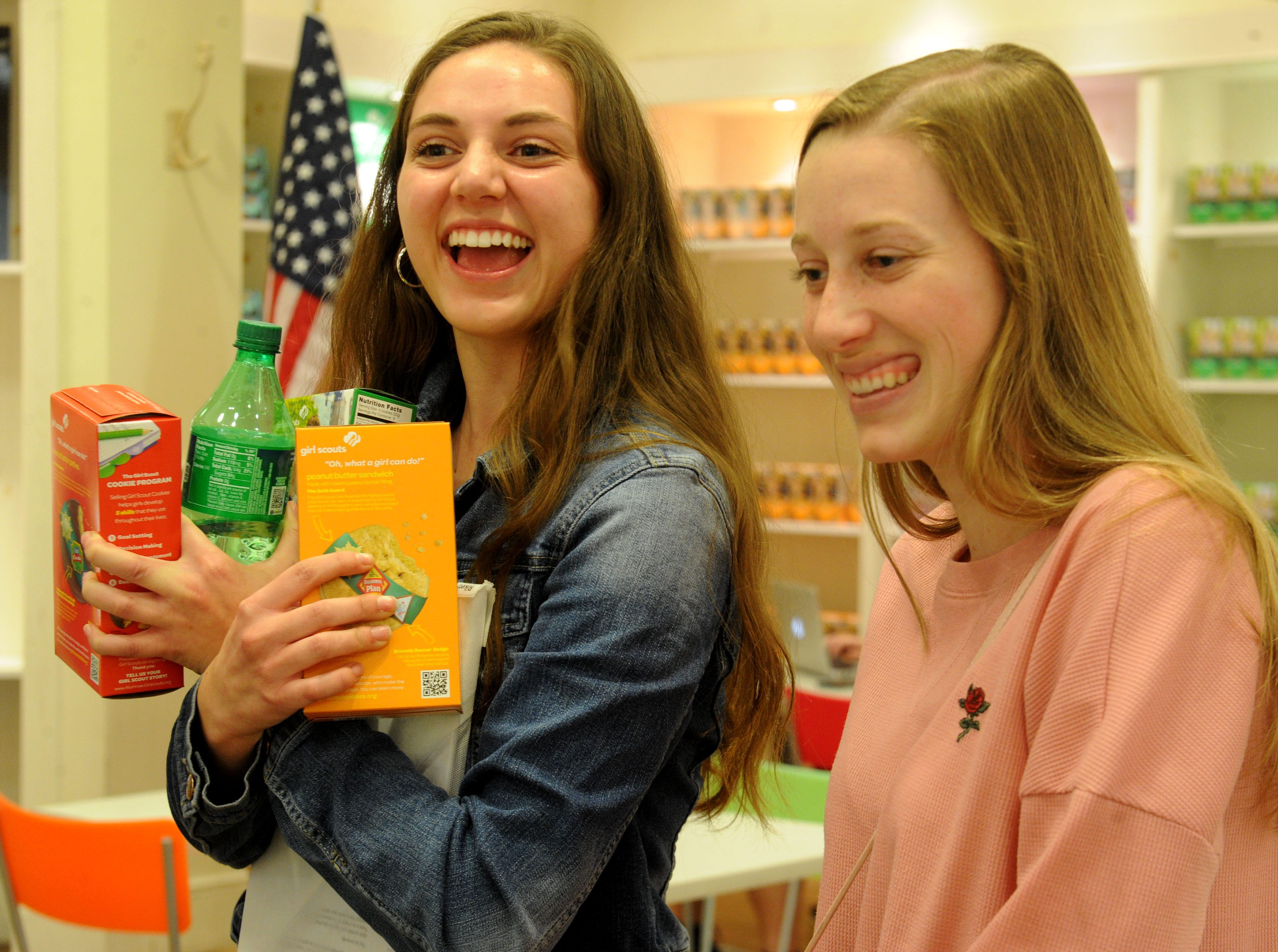 Lizzi Raker, left, and Kaylie Scofield buy three boxes of Girl Scout cookies  at the store in The Oaks mall.