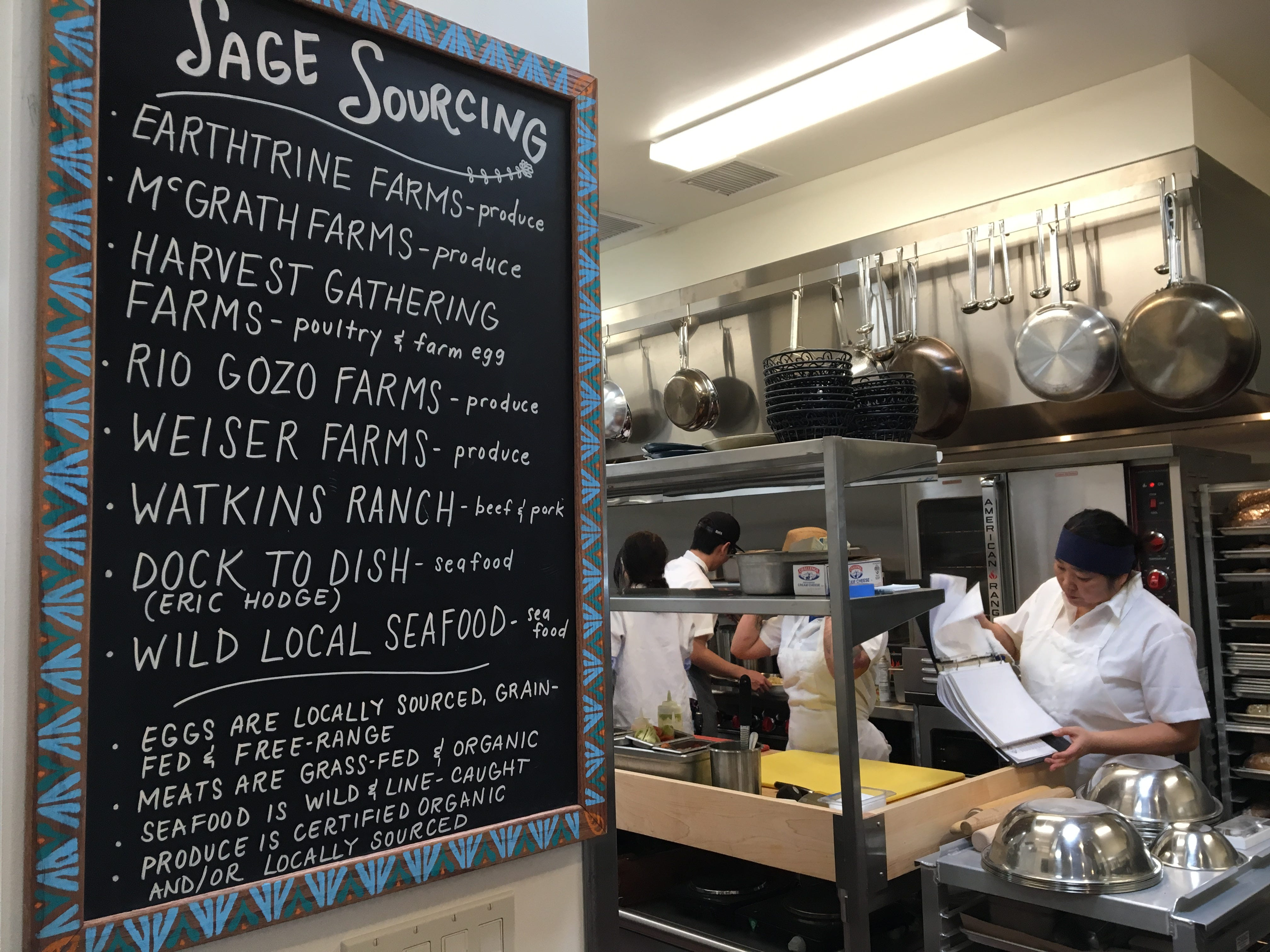 Local purveyors are listed on a chalkboard near the kitchen at Sage Mindful Meals & Elixirs in Ojai. The restaurant is open for breakfast and lunch, with plans to launch dinner service in the spring.