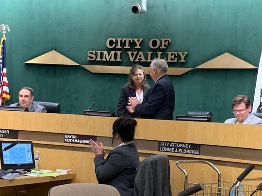 Small business owner Elaine Litster, shown on dais with Mayor Keith Mashburn, was appointed Thursday night by the Simi Valley City Council to fill a single vacancy on the five-member body.