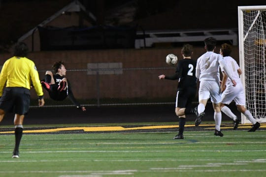 Adam Mockridge scores the game-winning goal for the Newbury Park High boys soccer team with six minutes to play against St. Francis in a CIF-Southern Section Division 2 first-round match on Thursday at Newbury Park.