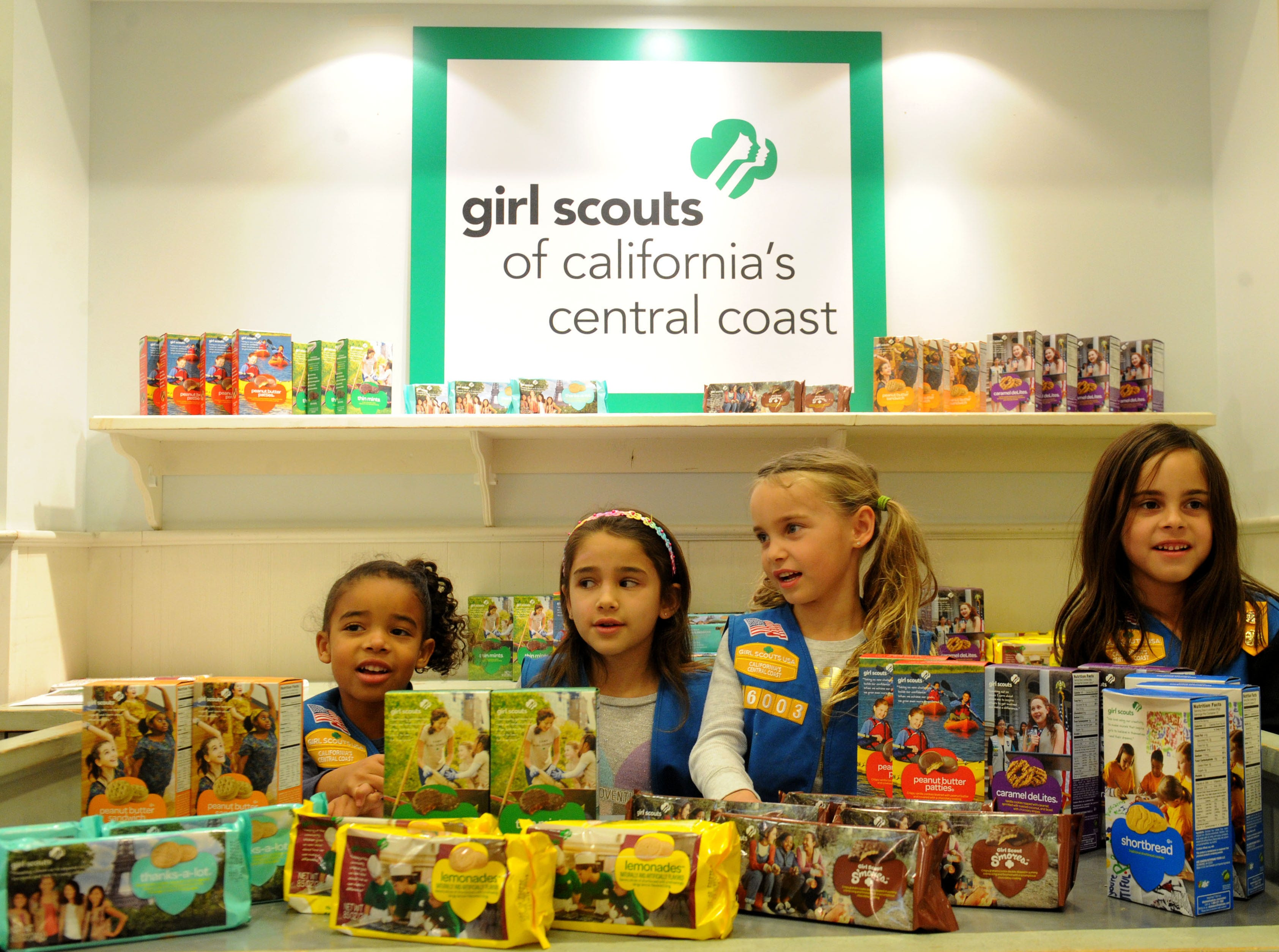 From left, Tamia Bragar, Talia Pannier, Avery Richards and Madison Richards sell their Girl Scout cookies at The Oaks mall. The Girl Scouts of California's Central Coast opened the storefront a few days ago.