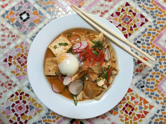 Lunch options at Sage Mindful Meals & Elixirs in Ojai include kimchi ramen hot pot with house-made, hand-cut noodles, tofu and shaved radish. Diners have the option of adding a poached egg for $2.