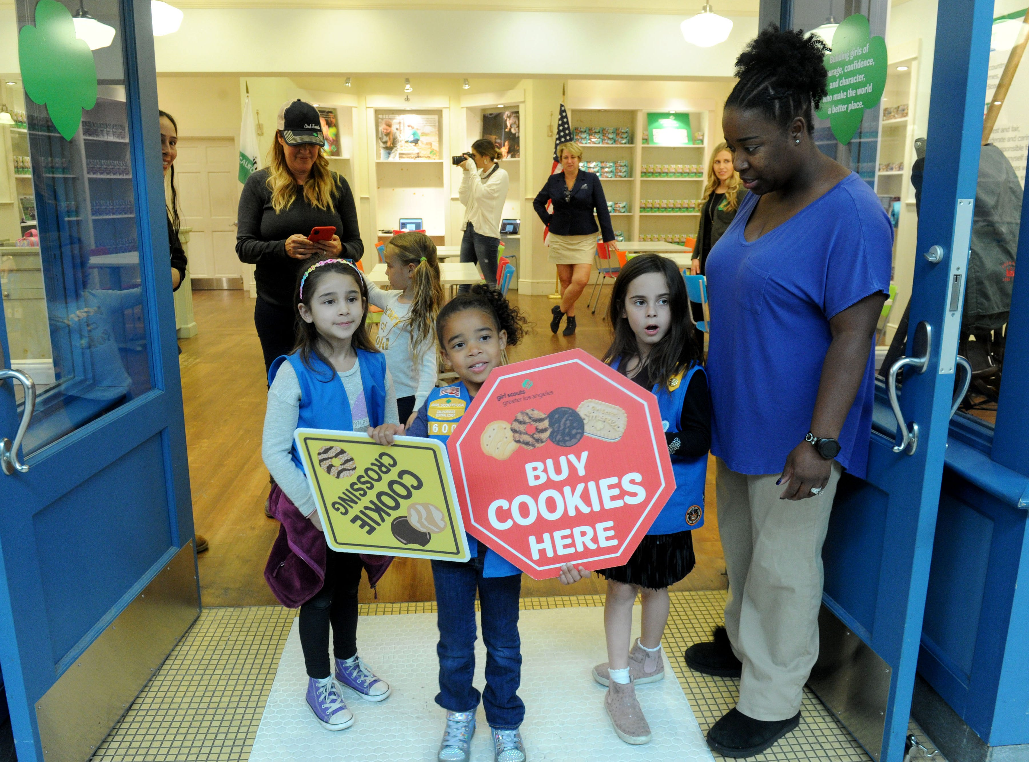 From left, Talia Pannier, Tamia Bragar, Madison Richards and Etevia Bragar stand near the door to attract Girl Scout cookie customers at The Oaks mall. The storefront is operating under the Girl Scouts of California's Central Coast.