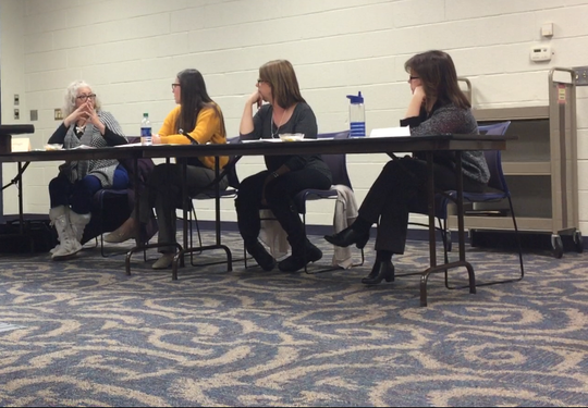 The board of trustees of the Vineland Public Library on Thursday approved a plan to layoff five employees to deal with a budget gap. Trustee Sheena Santiago (far left) speaks here to staff members during the meeting.