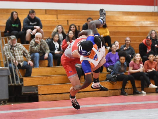 Vineland's Anthony Bencosme pinned Millville's Diane Johnson to win the 152 lb. wrestling bout held at Vineland High School on Thursday, Feb. 7, 2019. Millville defeated Vineland, 33-30.