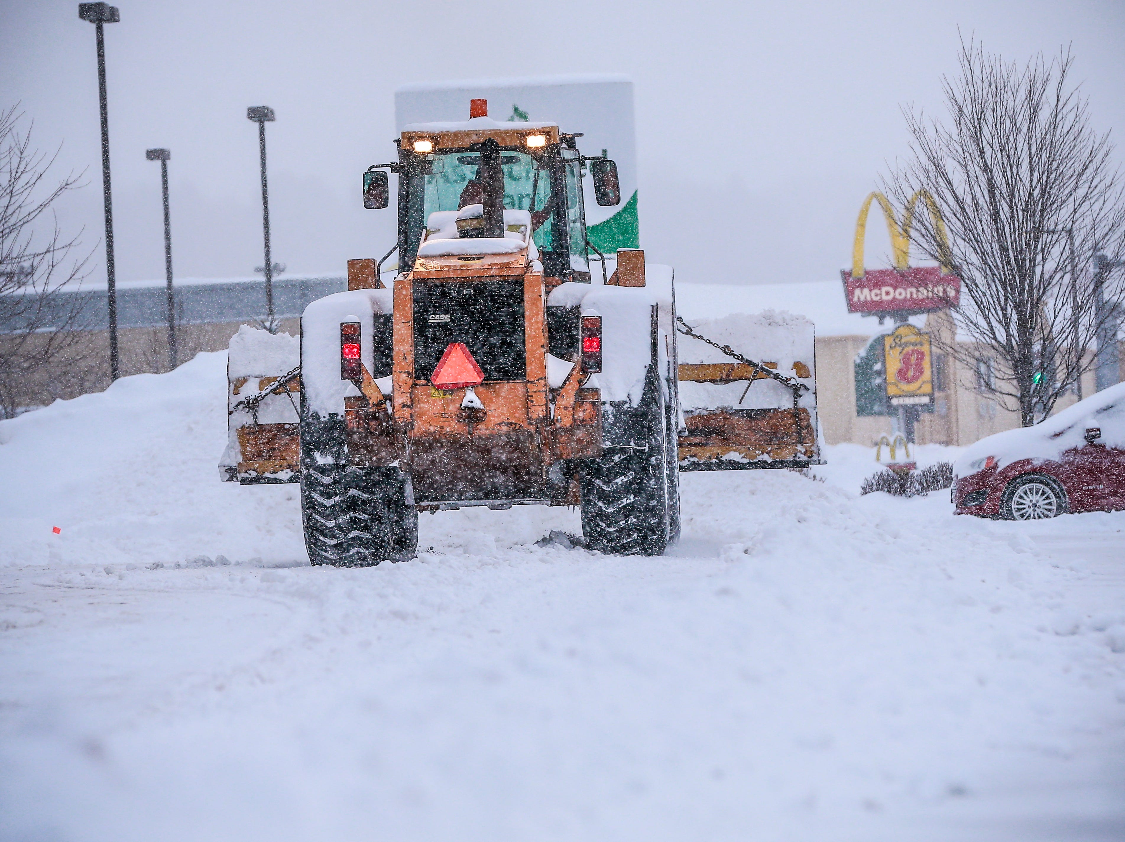A construction vehicle plows snow during a snowstorm Thursday, Feb. 07, 2019, in Wausau, Wis. T'xer Zhon Kha/USA TODAY NETWORK-Wisconsin
