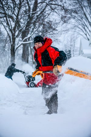 Nancy Jacobs clears snow on her sidewalk during a snowstorm Thursday, Feb. 07, 2019, in Wausau, Wis. T'xer Zhon Kha/USA TODAY NETWORK-Wisconsin