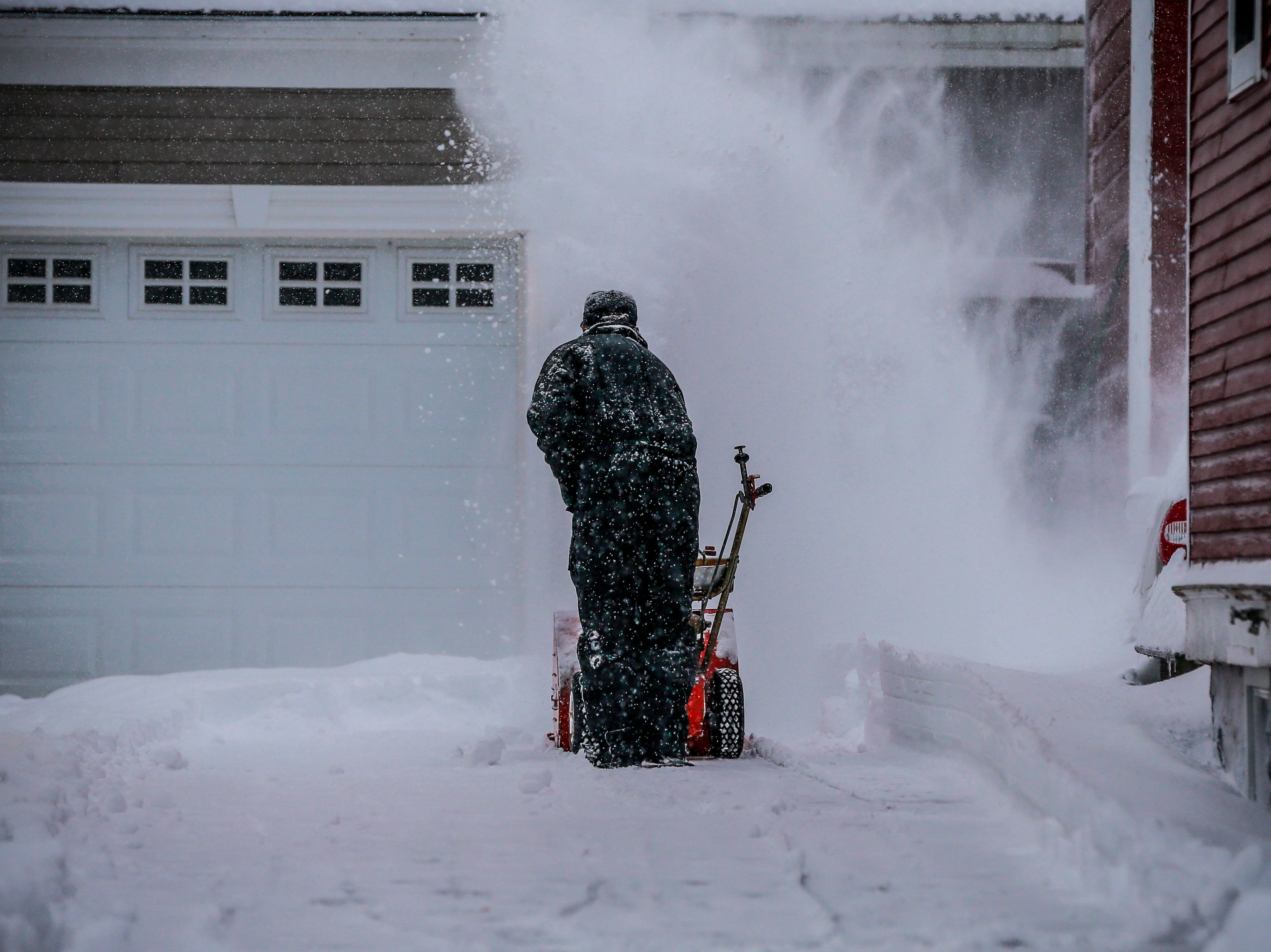 A James Lee plows his driveway Thursday, Feb. 07, 2019, in Wausau, Wis. T'xer Zhon Kha/USA TODAY NETWORK-Wisconsin