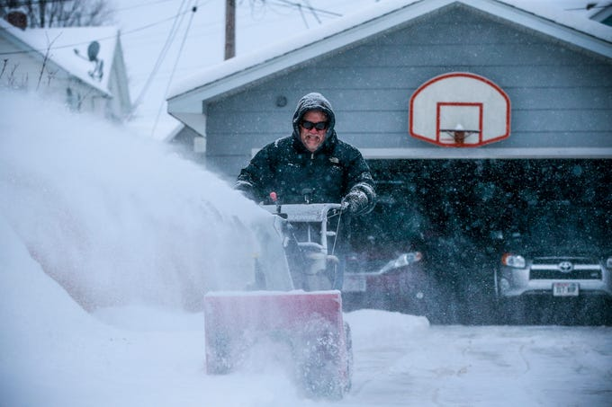 Andy Jacobs clears snow off from his driveway during a snowstorm Thursday, Feb. 07, 2019, in Wausau, Wis. T'xer Zhon Kha/USA TODAY NETWORK-Wisconsin