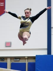 Caitlin Pellegrino, representing Lakeland/Panas/Putnam Valley, competes during the Section 1 gymnastics championships at Carmel High School Feb. 7,  2019.