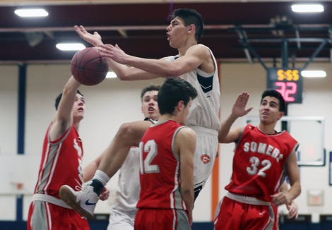 Greeley's Christopher Melis (3) drives to the basket against Somers during boys basketball action at Horace Greeley High School Feb. 7,  2019. Greeley won the game 71-47.