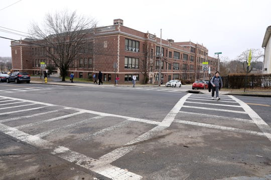 A sixth-grader crosses Main Street after school at Eastview Middle School Feb. 7, 2019 in White Plains.