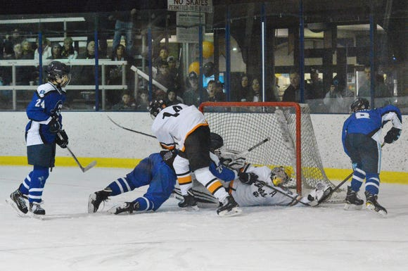 White Plains goalie Justin Schulz absorbs some punishment, but hangs on to the puck against Pearl River on Thursday, Feb. 7, 2019 at Ebersole Ice Rink. He made 21 saves in the 6-4 win.