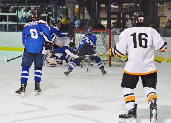 White Plains forward Devin Garnett plows into the crease to score the first goal of the game Thursday, Feb. 7, 2019 at Ebersole Ice Rink.