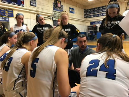 Pearl River girls basketball head coach Chris Woolgar talks to his team during a timeout in a game against Tappan Zee. Feb. 7, 2019.