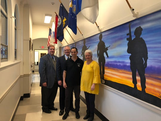Left to right: Clarkstown Supervisor George Hoehmann, Scott Milich of the Parks and Recreation Commission, artist Doron Viner and Parks and Recreation Superintendent Elaine Apfelbaum.