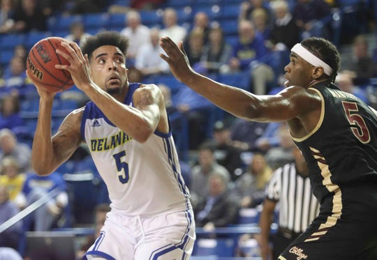 Delaware's Eric Carter looks to the basket past Charleston's Jarrell Brantley in the first half at the Bob Carpenter Center Thursday.