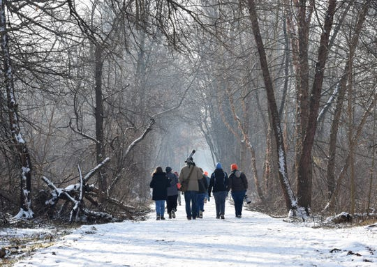 Members of the Delmarva Ornithological Society hit the snowy trails at the John Heinz National Wildlife Refuge at Tinicum near the Philadelphia International Airport to search for small, saw-whet owls during the 2019 owl walk hosted by the group.