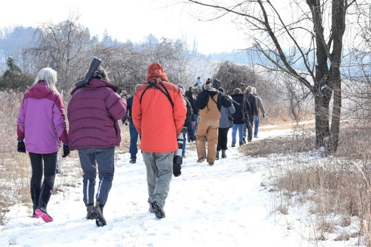Members of the Delmarva Ornithological Society hit the trails at the Delaware Nature Society's Coverdale Farm Preserve in Greenville to see if they can find a long-eared owl during the 2019 owl walk hosted by the group.