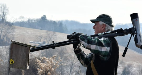 Jim White, who led the Delmarva Ornithological Society's 2019 owl trip, looks at a bird in the distance at the Delaware Nature Society's Coverdale Farm Preserve in Greenville.