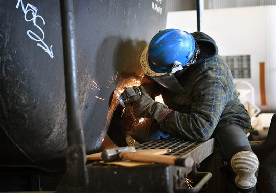 An Eagle Railcar Services worker performs a repair in the mechanical area of the plant on Allendale Road. The company employs 150 people with plans for further expansion.