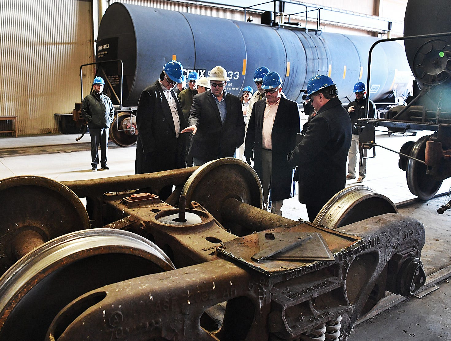 Eagle Railcar Services plant manager James Bullard conducts a tour of the facility for community leaders Friday. The company performs a wide variety of repair, repainting and maintenance services on almost every type of railcar.