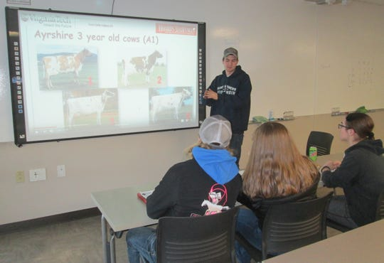 Fox Valley Technical College Ag student Sam Ziegler shares his dairy judging skills with high school learners.