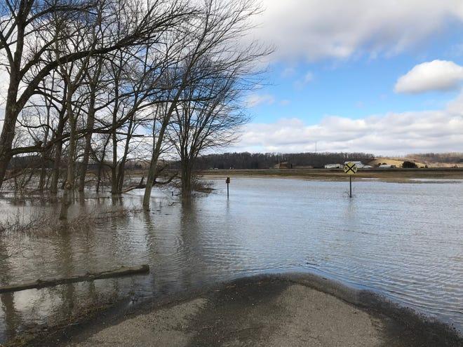 Spencer Road near Frazeysburg was flooded by Black Run on Friday, Feb. 8, 2019.