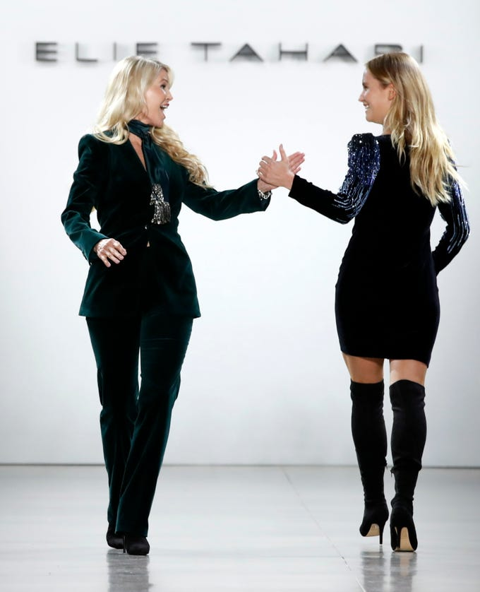 epa07351380 Model Sailor Lee Brinkley-Cook (R) high-fives her mother, former US model Christie Brinkley (L) as they present creations by Elie Tahari during the New York Fashion Week, in New York, New York, 07 February 2019. The Fall-Winter 2019/20 collections are presented from 06 to 13 February.  EPA-EFE/JASON SZENES ORG XMIT: JSX04