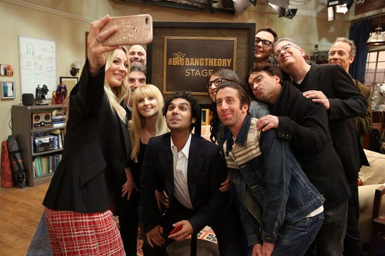 Kaley Cuoco, left, takes a group photo of 'The Big Bang Theory' cast and producers just after Warner Bros. dedicated the Burbank soundstage to the top-rated CBS comedy, which finishes its 12-season run in May.