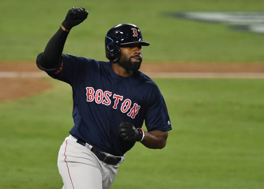 Boston Red Sox outfielder Jackie Bradley Jr. celebrates a home in the World Series.