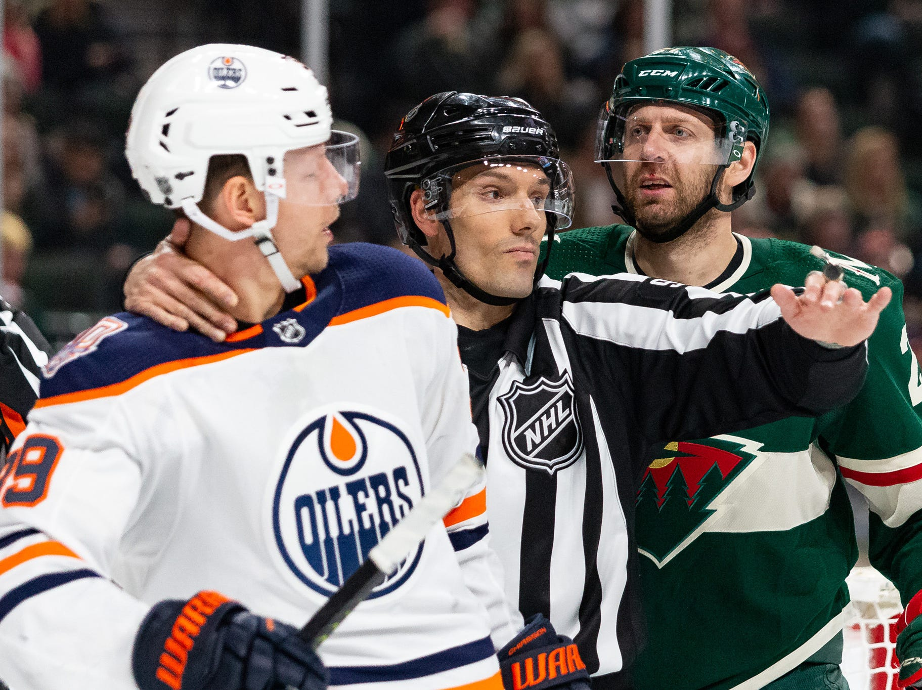 Feb 7: Linesman Brian Murphy breaks up a fight between Edmonton Oilers right wing Alex Chiasson, left, and Minnesota Wild right wing Eric Fehr .