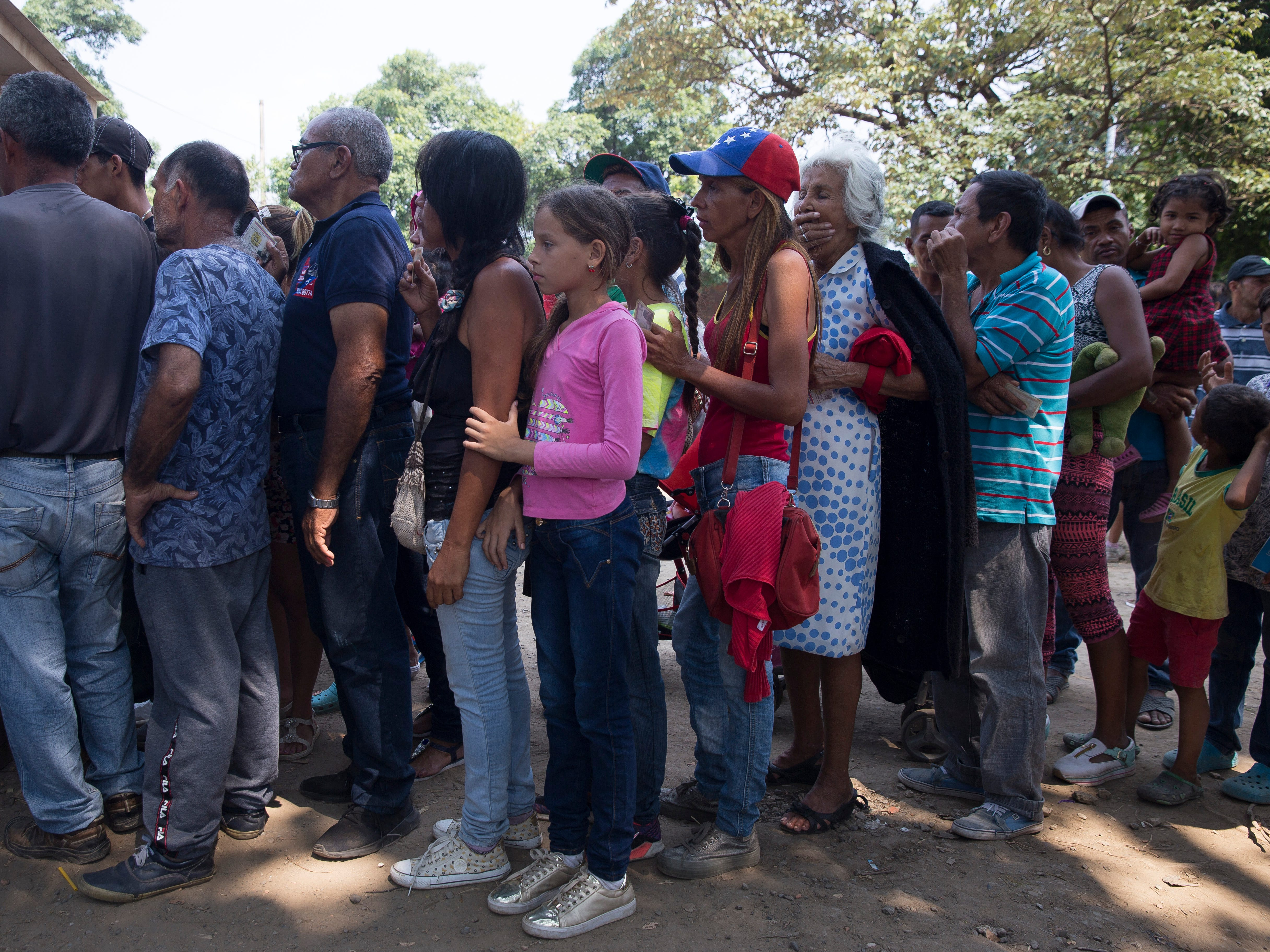 Migrants push together as they wait to enter a soup kitchen along the Colombia-Venezuela border in Cœcuta, Colombia on Feb. 6, 2019.