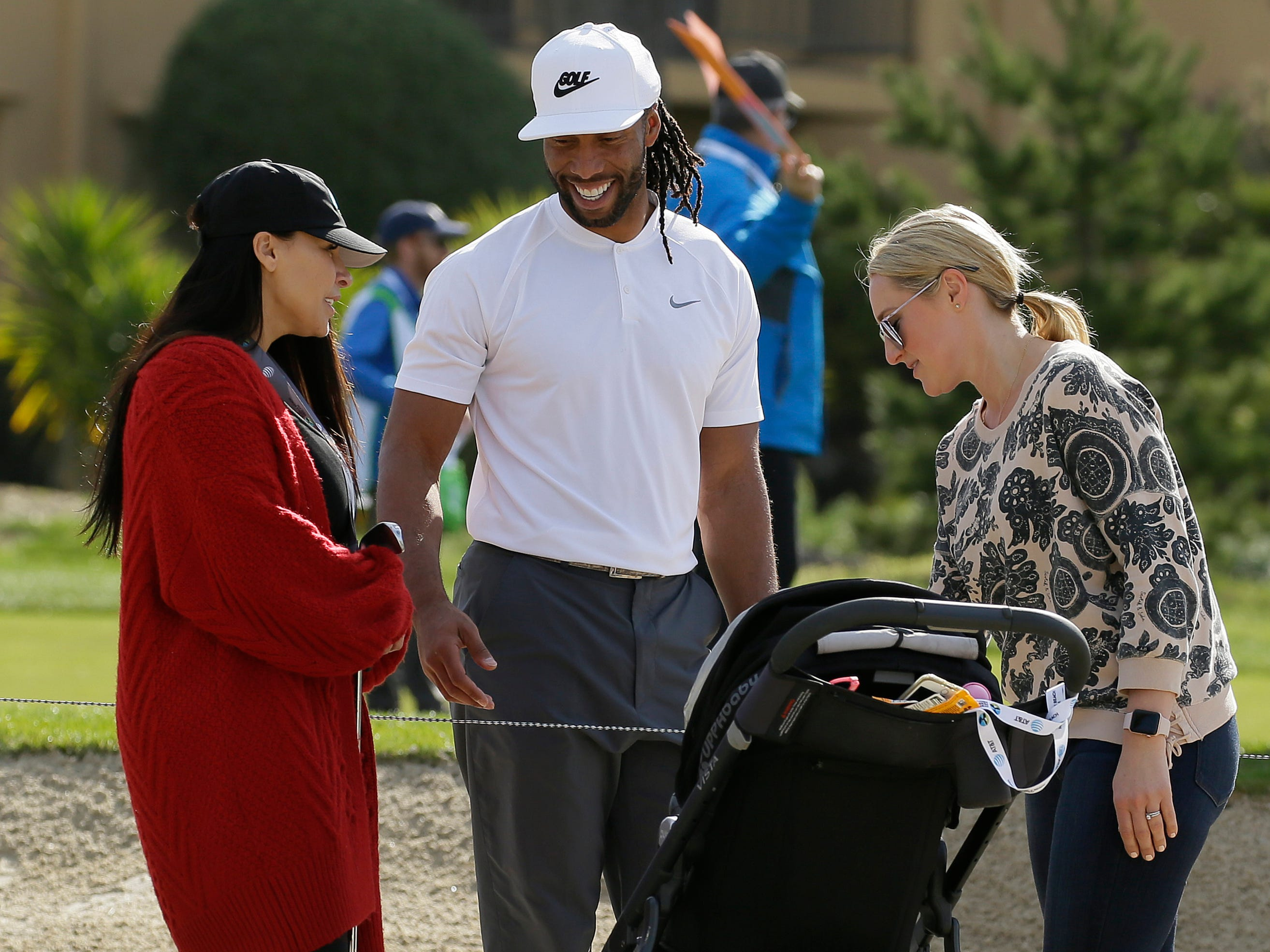 Cardinals WR Larry Fitzgerald Jr. stops to visit fans on the fourth hole of the Monterey Peninsula Country Club Shore Course during the first round of the AT&T Pebble Beach National Pro-Am.