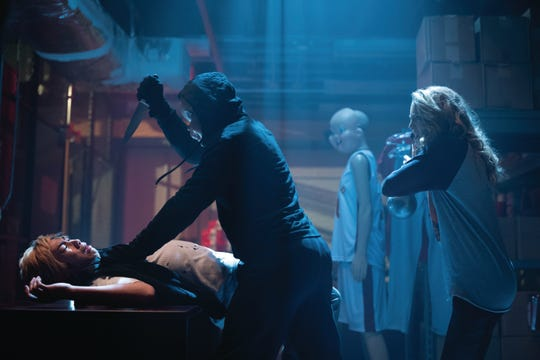 """Tree (Jessica Rothe, right) defends Ryan (Phi Vu, left) in """"Happy Death Day 2U."""""""
