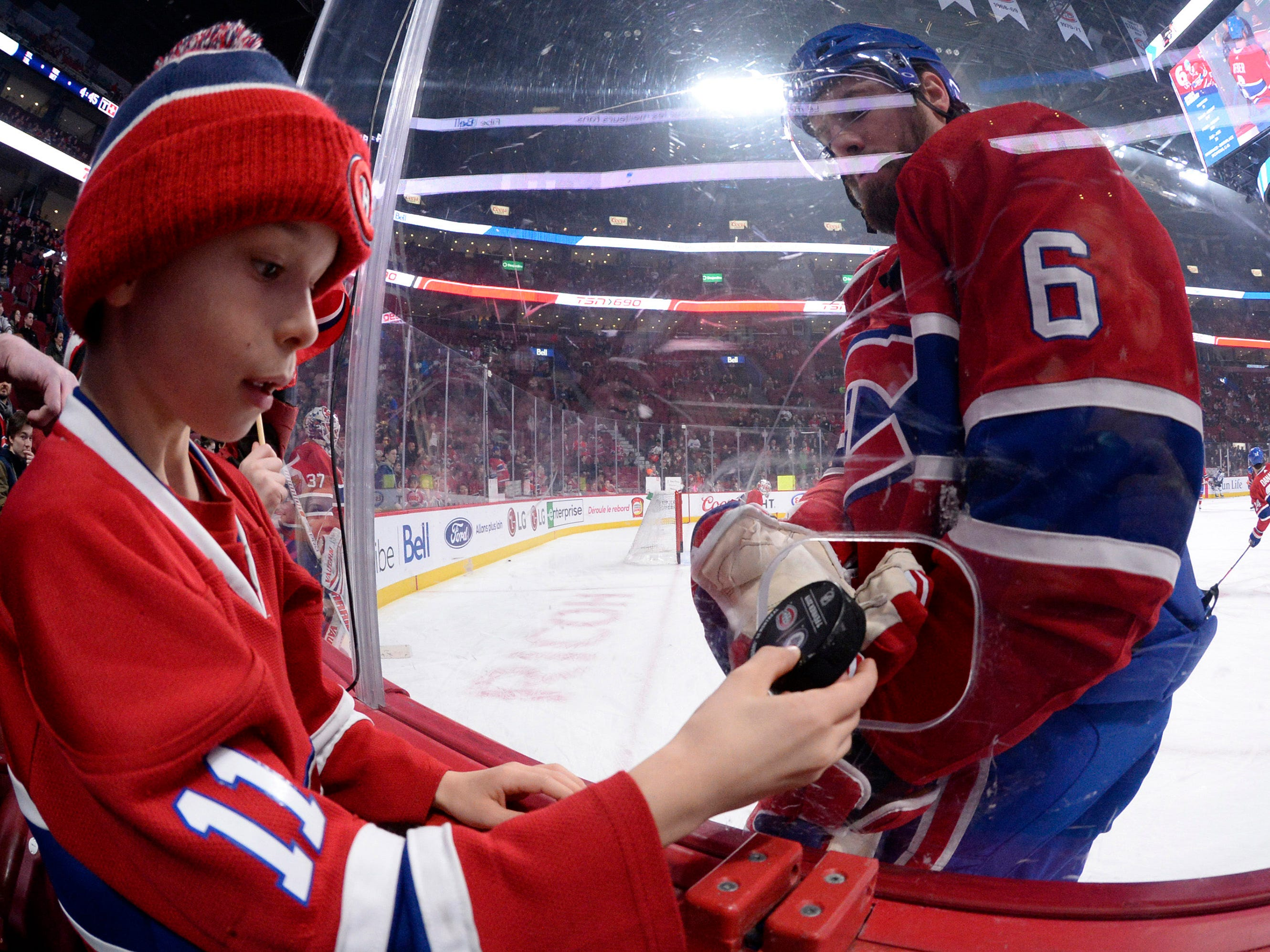 Feb. 7: Canadiens captain Shea Weber gives a puck to a young fan prior to Montreal's 5-2 win over the Winnipeg Jets at the Bell Centre.