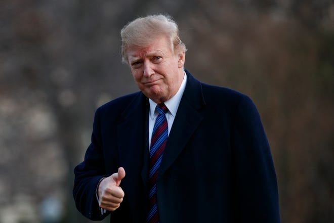 President Donald Trump gives a thumbs-up after arriving on Marine One on the South Lawn of the White House in Washington, D.C., Feb. 8, 2019. The president was returning to the White House after his annual physical exam at Walter Reed National Military Medical Center.