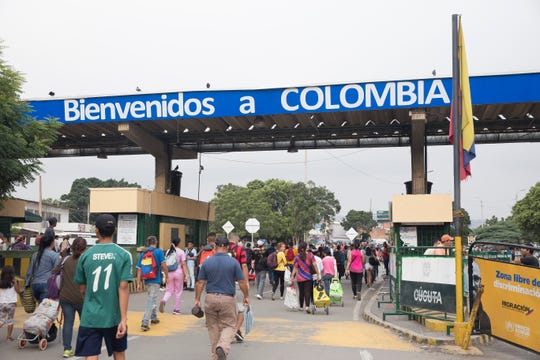 Thousands of migrants flood into Colombia from Venezuela in Cœcuta, Colombia, on Feb. 6. More than 40,000 Venezuelans cross the bridge daily as their country collapses.