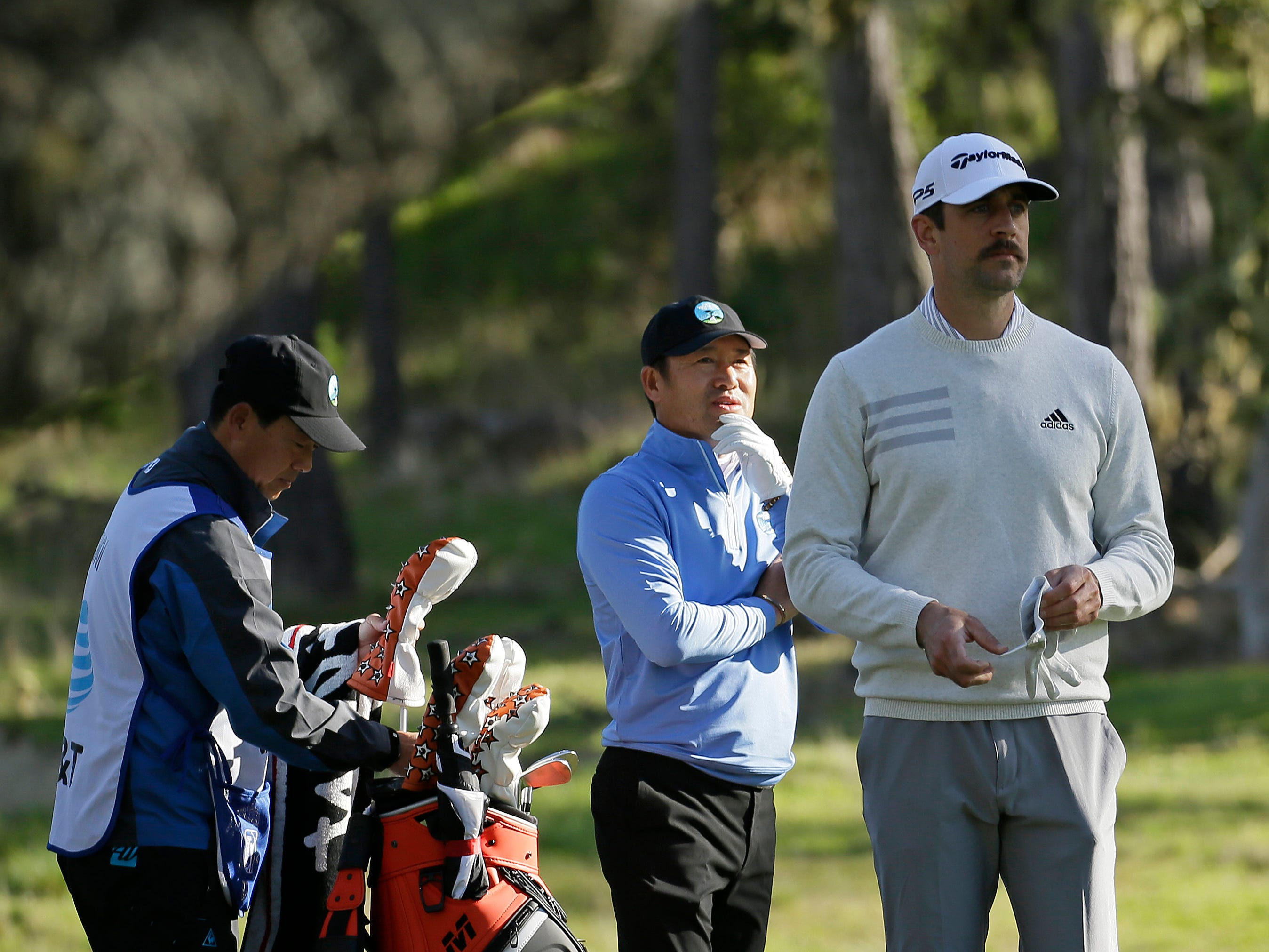 Packers QB Aaron Rodgers and pro golfer, viral sensation Ho-Sung Choi wait to hit from the fourth tee of the Monterey Peninsula Country Club Shore Course during the first round of the AT&T Pebble Beach National Pro-Am.